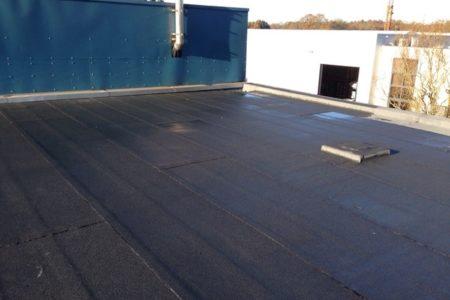 plat dak herstellen roofing